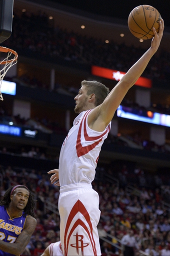 Nov 7, 2013; Houston, TX, USA; Houston Rockets small forward Chandler Parsons (25) grabs a rebound against the Los Angeles Lakers during the second half at Toyota Center. The Lakers won 99-98. Mandatory Credit: Thomas Campbell-USA TODAY Sports