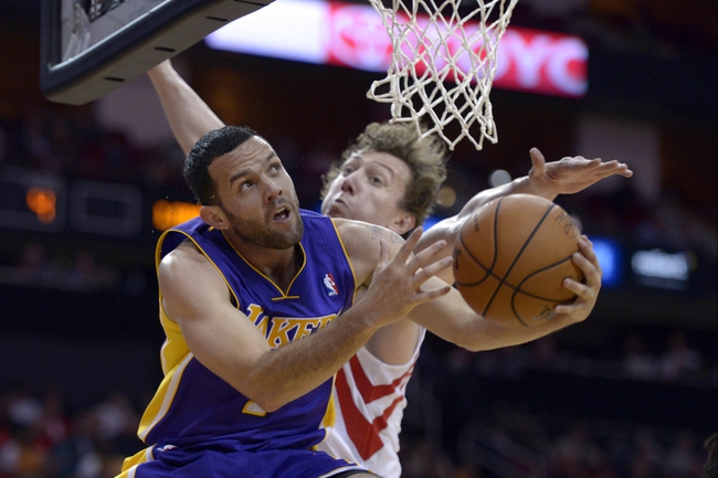 Nov 7, 2013; Houston, TX, USA; Los Angeles Lakers point guard Jordan Farmar (1) drives against Houston Rockets3 during the second half at Toyota Center. The Lakers won 99-98. Mandatory Credit: Thomas Campbell-USA TODAY Sports
