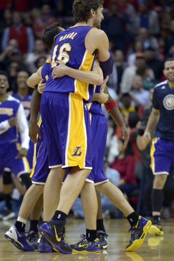 Nov 7, 2013; Houston, TX, USA; Los Angeles Lakers point guard Steve Blake (5) celebrates hitting a game-winning three point shot with center Pau Gasol (16) against the Houston Rockets during the second half at Toyota Center. The Lakers won 99-98. Mandatory Credit: Thomas Campbell-USA TODAY Sports