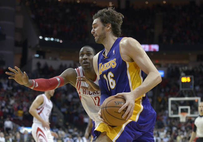 Nov 7, 2013; Houston, TX, USA; Los Angeles Lakers center Pau Gasol (16) drives on Houston Rockets center Dwight Howard (12) during the second half at Toyota Center. The Lakers won 99-98. Mandatory Credit: Thomas Campbell-USA TODAY Sports