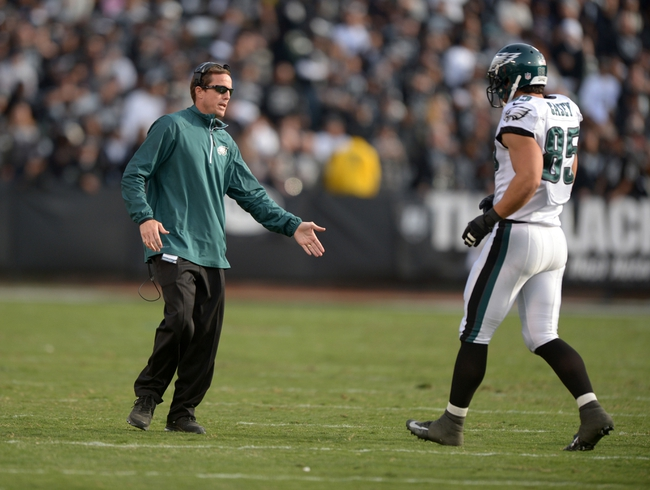 Nov 3, 2013; Oakland, CA, USA; Philadelphia Eagles special teams coordinator Dave Fipp (left) greets tight end James Casey (85) during the game against the Oakland Raiders at O.co Coliseum. The Eagles defeated the Raiders 49-20. Mandatory Credit: Kirby Lee-USA TODAY Sports