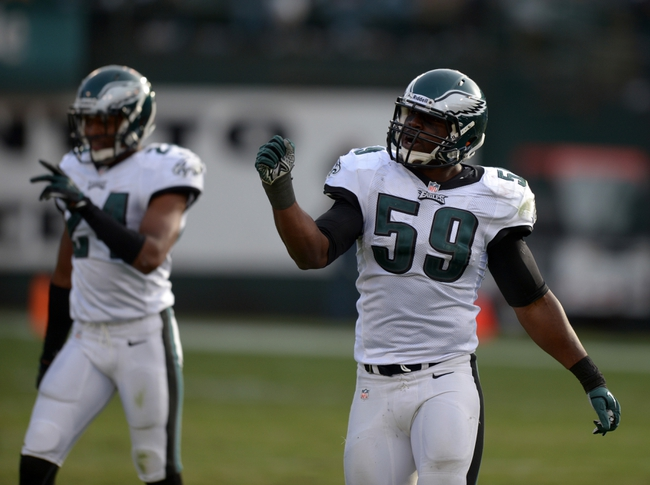 Nov 3, 2013; Oakland, CA, USA; Philadelphia Eagles linebacker DeMeco Ryans (59) and cornerback Bradley Fletcher (24) celebrate during the game against the Oakland Raiders at O.co Coliseum. The Eagles defeated the Raiders 49-20. Mandatory Credit: Kirby Lee-USA TODAY Sports