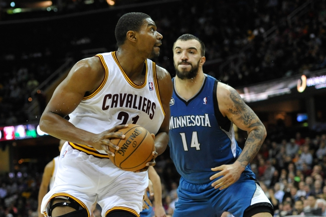 Nov 4, 2013; Cleveland, OH, USA; Cleveland Cavaliers center Andrew Bynum (21) and Minnesota Timberwolves center Nikola Pekovic (14) during a game at Quicken Loans Arena. Cleveland won 93-92. Mandatory Credit: David Richard-USA TODAY Sports