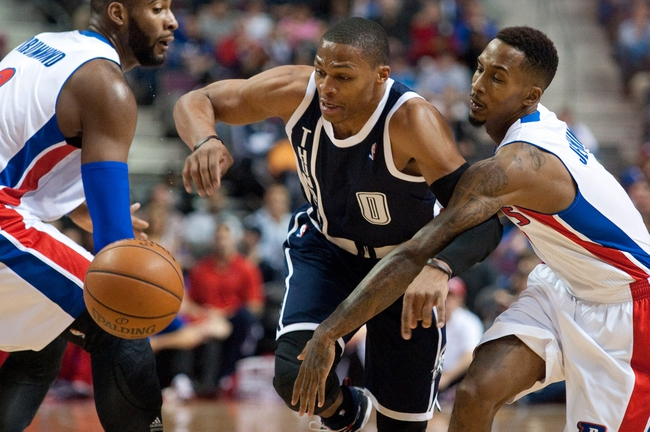 Nov 8, 2013; Auburn Hills, MI, USA; Detroit Pistons center Andre Drummond (left) and point guard Brandon Jennings (7) guard Oklahoma City Thunder point guard Russell Westbrook (0) during the first quarter at The Palace of Auburn Hills. Mandatory Credit: Tim Fuller-USA TODAY Sports