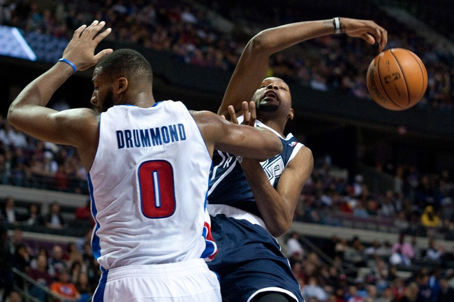 Nov 8, 2013; Auburn Hills, MI, USA; Detroit Pistons center Andre Drummond (0) fouls Oklahoma City Thunder small forward Kevin Durant (35) during the second quarter at The Palace of Auburn Hills. Mandatory Credit: Tim Fuller-USA TODAY Sports