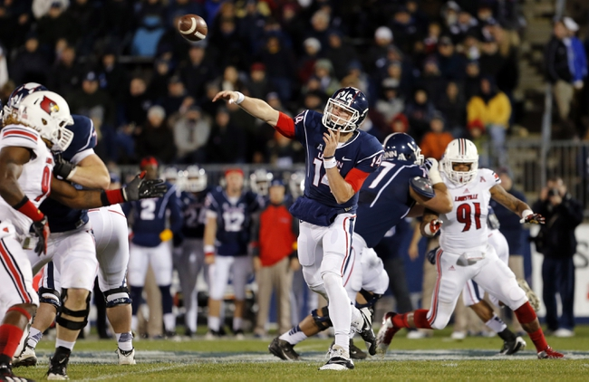 Nov 8, 2013; East Hartford, CT, USA; Connecticut Huskies quarterback Tim Boyle (14) throws a pass against the Louisville Cardinals in the first quarter at Rentschler Field. Mandatory Credit: David Butler II-USA TODAY Sports