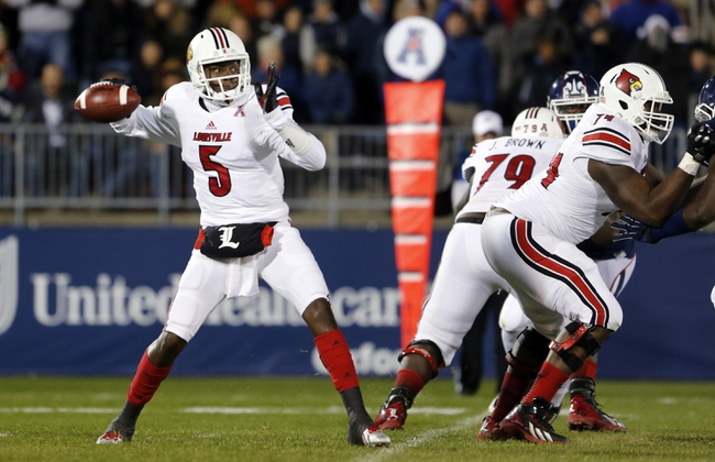 Nov 8, 2013; East Hartford, CT, USA; Louisville Cardinals quarterback Teddy Bridgewater (5) throws a pass against the Connecticut Huskies in the first quarter at Rentschler Field. Mandatory Credit: David Butler II-USA TODAY Sports