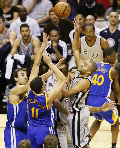 Nov 8, 2013; San Antonio, TX, USA; San Antonio Spurs guard Tony Parker (9) takes a shot over Golden State Warriors guard Klay Thompson (11) during the first half at AT&T Center. Mandatory Credit: Soobum Im-USA TODAY Sports