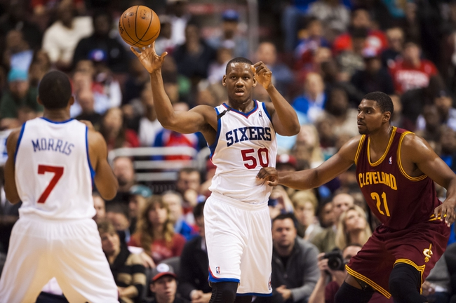 Nov 8, 2013; Philadelphia, PA, USA; Philadelphia 76ers center Lavoy Allen (50) passes the ball to guard Darius Morris (7) during the fourth quarter against the Cleveland Cavaliers at Wells Fargo Center. The Sixers defeated the Cavaliers 94-79. Mandatory Credit: Howard Smith-USA TODAY Sports