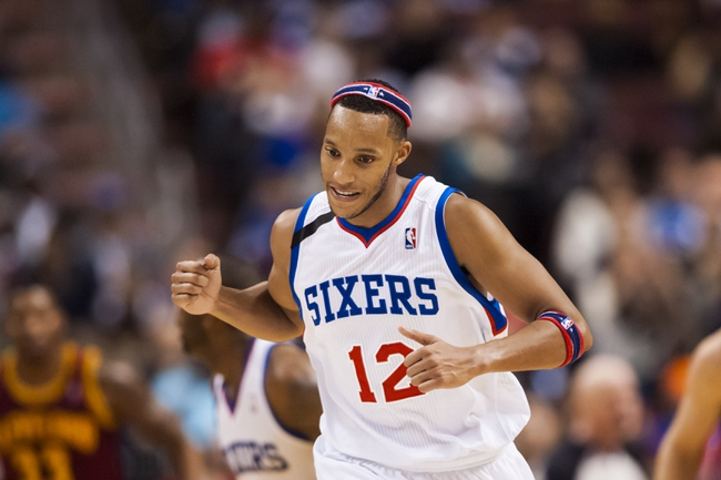 Nov 8, 2013; Philadelphia, PA, USA; Philadelphia 76ers guard Evan Turner (12) celebrates during the fourth quarter against the Cleveland Cavaliers at Wells Fargo Center. The Sixers defeated the Cavaliers 94-79. Mandatory Credit: Howard Smith-USA TODAY Sports