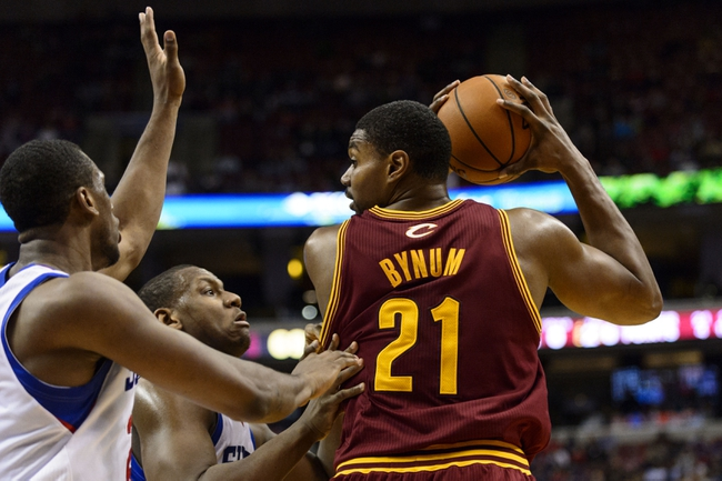 Nov 8, 2013; Philadelphia, PA, USA; Cleveland Cavaliers center Andrew Bynum (21) is defended by Philadelphia 76ers forward Thaddeus Young (21) and center Lavoy Allen (50) during the fourth quarter at Wells Fargo Center. The Sixers defeated the Cavaliers 94-79. Mandatory Credit: Howard Smith-USA TODAY Sports
