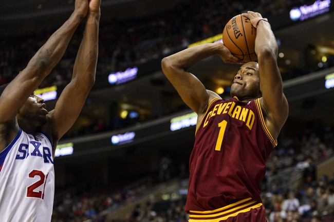 Nov 8, 2013; Philadelphia, PA, USA; Cleveland Cavaliers guard Jarrett Jack (1) shoots a jump shot under pressure from Philadelphia 76ers forward Thaddeus Young (21) during the fourth quarter at Wells Fargo Center. The Sixers defeated the Cavaliers 94-79. Mandatory Credit: Howard Smith-USA TODAY Sports