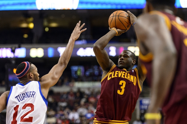 Nov 8, 2013; Philadelphia, PA, USA; Cleveland Cavaliers guard Dion Waiters (3) shoots over the defense of Philadelphia 76ers guard Evan Turner (12) during the fourth quarter at Wells Fargo Center. The Sixers defeated the Cavaliers 94-79. Mandatory Credit: Howard Smith-USA TODAY Sports