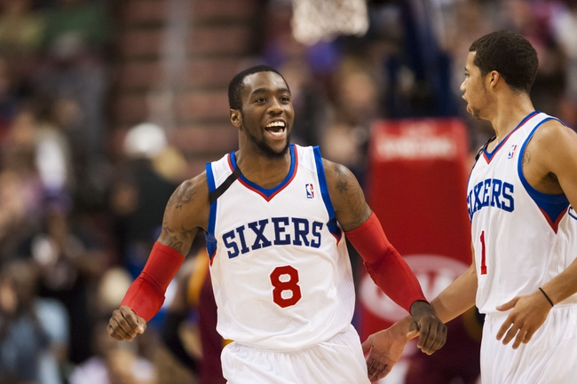 Nov 8, 2013; Philadelphia, PA, USA; Philadelphia 76ers guard Tony Wroten (8) celebrates with guard Michael Carter-Williams (1) during the fourth quarter against the Cleveland Cavaliers at Wells Fargo Center. The Sixers defeated the Cavaliers 94-79. Mandatory Credit: Howard Smith-USA TODAY Sports