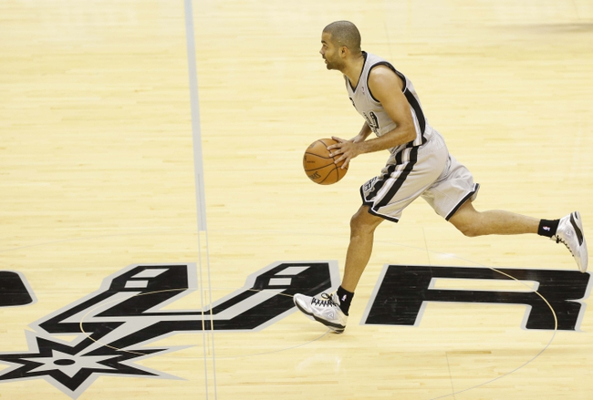 Nov 8, 2013; San Antonio, TX, USA; San Antonio Spurs guard Tony Parker (9) brings the ball up court during the first half against the Golden State Warriors at AT&T Center. Mandatory Credit: Soobum Im-USA TODAY Sports