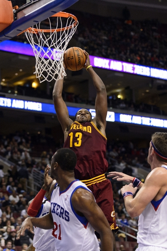 Nov 8, 2013; Philadelphia, PA, USA; Cleveland Cavaliers forward Tristan Thompson (13) pulls down a rebound during the third quarter against the Philadelphia 76ers at Wells Fargo Center. The Sixers defeated the Cavaliers 94-79. Mandatory Credit: Howard Smith-USA TODAY Sports