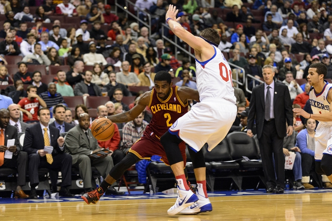 Nov 8, 2013; Philadelphia, PA, USA; Cleveland Cavaliers guard Kyrie Irving (2) is defended by Philadelphia 76ers center Spencer Hawes (00) during the third quarter at Wells Fargo Center. The Sixers defeated the Cavaliers 94-79. Mandatory Credit: Howard Smith-USA TODAY Sports