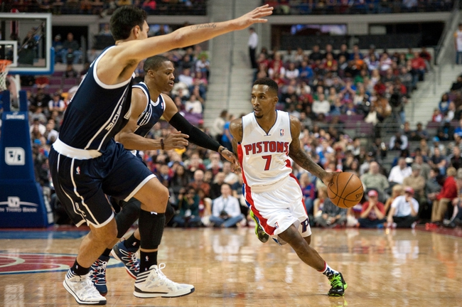 Nov 8, 2013; Auburn Hills, MI, USA; Detroit Pistons point guard Brandon Jennings (7) drives past Oklahoma City Thunder point guard Russell Westbrook (0) and center Steven Adams (12) during the fourth quarter at The Palace of Auburn Hills. Mandatory Credit: Tim Fuller-USA TODAY Sports