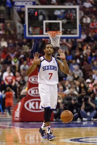Nov 8, 2013; Philadelphia, PA, USA; Philadelphia 76ers guard Darius Morris (7) calls a play during the fourth quarter against the Cleveland Cavaliers at Wells Fargo Center. The Sixers defeated the Cavaliers 94-79. Mandatory Credit: Howard Smith-USA TODAY Sports