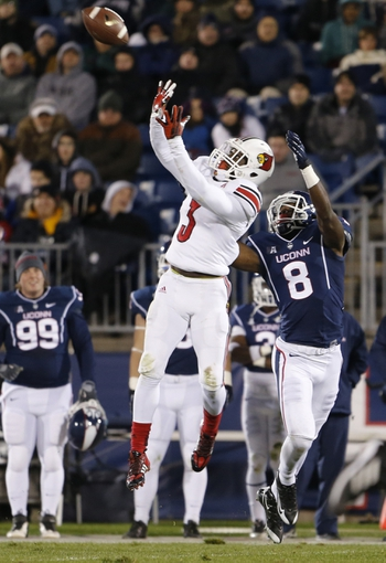 Nov 8, 2013; East Hartford, CT, USA; Louisville Cardinals cornerback Charles Gaines (3) intercepts a pass intended for Connecticut Huskies wide receiver Shakim Phillips (8)  in the second quarter at Rentschler Field. Mandatory Credit: David Butler II-USA TODAY Sports