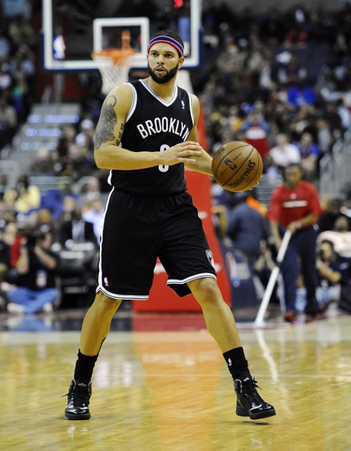 Nov 8, 2013; Washington, DC, USA; Brooklyn Nets point guard Deron Williams (8) dribbles the ball against the Washington Wizards during the second half at the Verizon Center. The Wizards defeated the Nets 112 - 108. Mandatory Credit: Brad Mills-USA TODAY Sports
