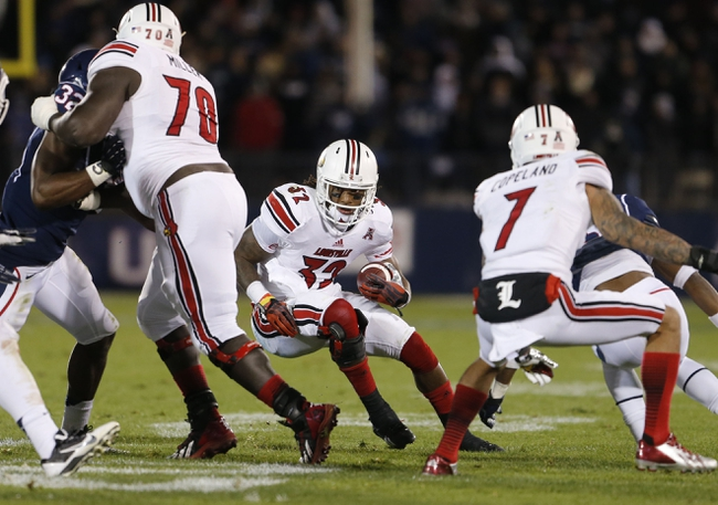 Nov 8, 2013; East Hartford, CT, USA; Louisville Cardinals running back Senorise Perry (32) runs the ball against the Connecticut Huskies in the second quarter at Rentschler Field. Mandatory Credit: David Butler II-USA TODAY Sports