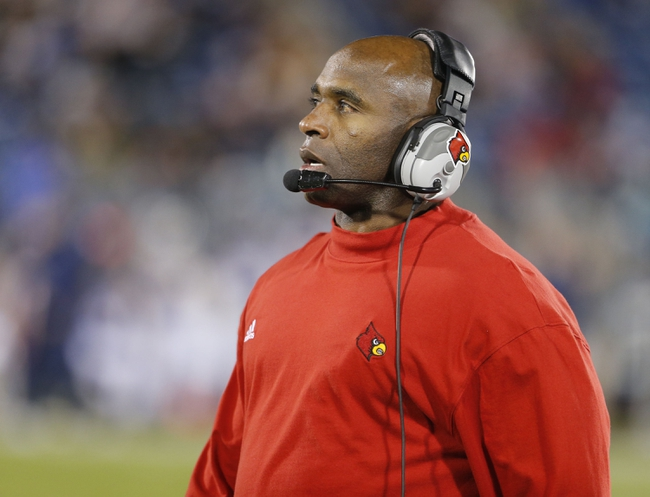 Nov 8, 2013; East Hartford, CT, USA; Louisville Cardinals head coach Charlie Strong watches from the sideline as they take on the Connecticut Huskies in the second quarter at Rentschler Field. Mandatory Credit: David Butler II-USA TODAY Sports