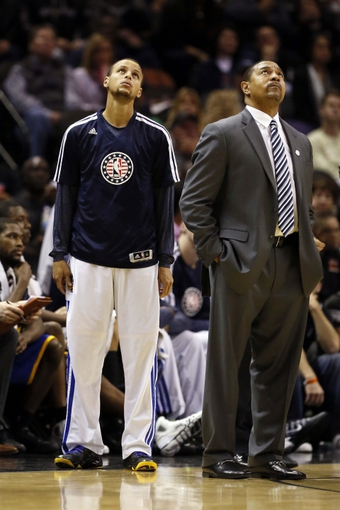 Nov 8, 2013; San Antonio, TX, USA; Golden State Warriors head coach Mark Jackson (right) and guard Stephen Curry (left) watch the replay during a timeout against the San Antonio Spurs at AT&T Center. The Spurs won 76-74. Mandatory Credit: Soobum Im-USA TODAY Sports