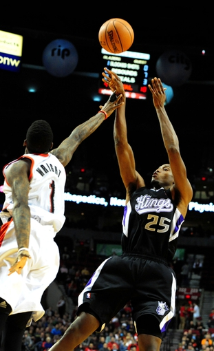 Nov 8, 2013; Portland, OR, USA; Sacramento Kings small forward Travis Outlaw (25) shoots over Portland Trail Blazers small forward Dorell Wright (1)during the first quarter of the game at the Moda Center. Mandatory Credit: Steve Dykes-USA TODAY Sports