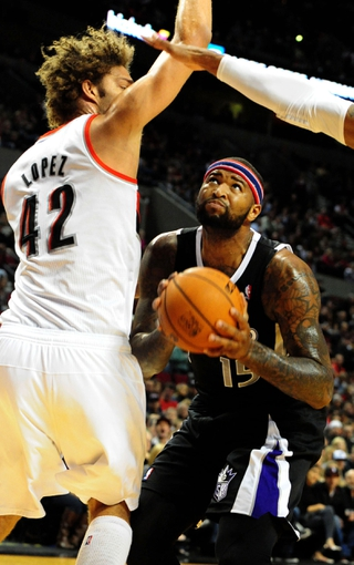 Nov 8, 2013; Portland, OR, USA; Sacramento Kings center DeMarcus Cousins (15) looks to shoot past Portland Trail Blazers center Robin Lopez (42) during the first quarter of the game at the Moda Center. Mandatory Credit: Steve Dykes-USA TODAY Sports