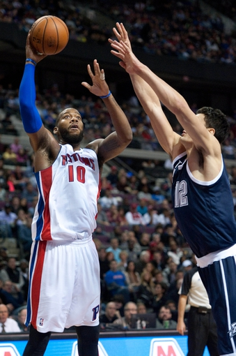 Nov 8, 2013; Auburn Hills, MI, USA; Detroit Pistons power forward Greg Monroe (10) shoots during the third quarter against the Oklahoma City Thunder at The Palace of Auburn Hills. Mandatory Credit: Tim Fuller-USA TODAY Sports