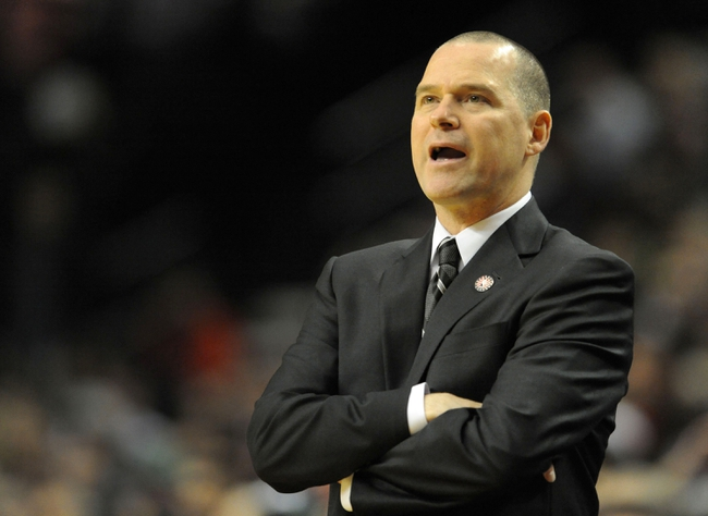 Nov 8, 2013; Portland, OR, USA; Sacramento Kings head coach Michael Malone yells out to his team during the first quarter of the game against the Portland Trail Blazers at the Moda Center. Mandatory Credit: Steve Dykes-USA TODAY Sports