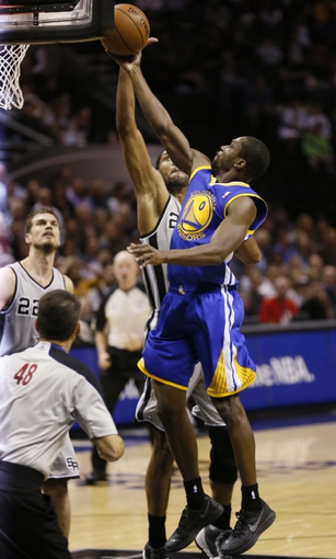 Nov 8, 2013; San Antonio, TX, USA; Golden State Warriors guard Toney Douglas (front) has his shot blocked by San Antonio Spurs forward Tim Duncan (behind) during the second half at AT&T Center. The Spurs won 76-74. Mandatory Credit: Soobum Im-USA TODAY Sports