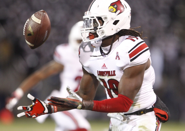 Nov 8, 2013; East Hartford, CT, USA; Louisville Cardinals cornerback Terell Floyd (19) makes the interception and returns the ball for a touchdown against the Connecticut Huskies in the second half at Rentschler Field. Louisville defeated UConn 31-10. Mandatory Credit: David Butler II-USA TODAY Sports