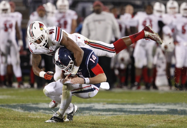 Nov 8, 2013; East Hartford, CT, USA; Louisville Cardinals defensive end Marcus Smith (91) sacks Connecticut Huskies quarterback Tim Boyle (14) in the second half at Rentschler Field. Louisville defeated UConn 31-10. Mandatory Credit: David Butler II-USA TODAY Sports