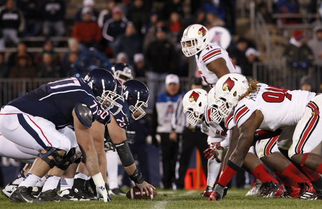 Nov 8, 2013; East Hartford, CT, USA; The Connecticut Huskies take on the Louisville Cardinals in the second half at Rentschler Field. Louisville defeated UConn 31-10. Mandatory Credit: David Butler II-USA TODAY Sports