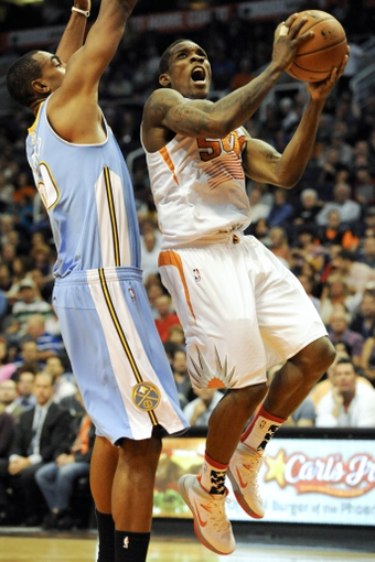 Nov 8, 2013; Phoenix, AZ, USA; Phoenix Suns point guard Eric Bledsoe (2) shoots the ball under pressure from Denver Nuggets power forward Darrell Arthur (00) during the fourth quarter at US Airways Center. The Suns defeated the Nuggets 114-103. Mandatory Credit: Casey Sapio-USA TODAY Sports