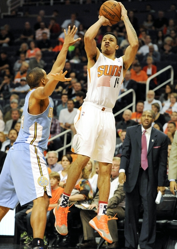Nov 8, 2013; Phoenix, AZ, USA; Phoenix Suns shooting guard Gerald Green (14) shoots the ball over Denver Nuggets point guard Andre Miller (24) during the third quarter at US Airways Center. The Suns defeated the Nuggets 114-103. Mandatory Credit: Casey Sapio-USA TODAY Sports