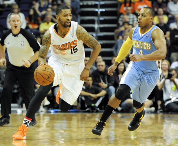 Nov 8, 2013; Phoenix, AZ, USA; Phoenix Suns power forward Marcus Morris (15) dribbles the ball under pressure from Denver Nuggets shooting guard Randy Foye (4) during the fourth quarter at US Airways Center. The Suns defeated the Nuggets 114-103. Mandatory Credit: Casey Sapio-USA TODAY Sports