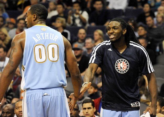 Nov 8, 2013; Phoenix, AZ, USA; Denver Nuggets power forward Darrell Arthur (00) and small forward Kenneth Faried (35) high five during the third quarter against the Phoenix Suns at US Airways Center. The Suns defeated the Nuggets 114-103. Mandatory Credit: Casey Sapio-USA TODAY Sports