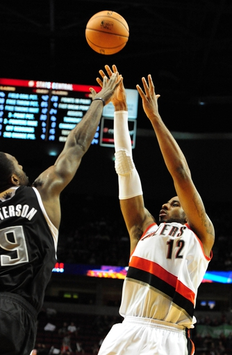 Nov 8, 2013; Portland, OR, USA; Portland Trail Blazers power forward LaMarcus Aldridge (12) shoots the ball over Sacramento Kings power forward Patrick Patterson (9) during the fourth quarter of the game at the Moda Center. The Blazers won the game 104-91. Mandatory Credit: Steve Dykes-USA TODAY Sports