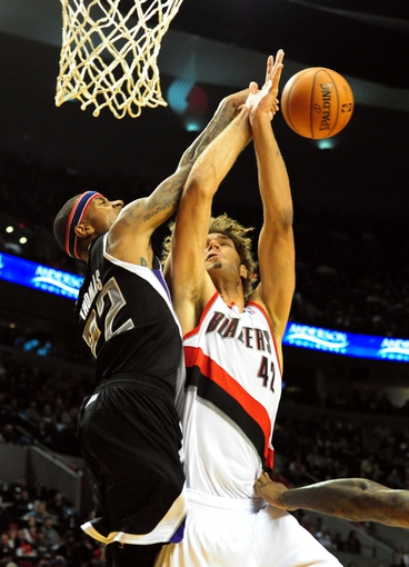 Nov 8, 2013; Portland, OR, USA; Sacramento Kings point guard Isaiah Thomas (22) fouls Portland Trail Blazers center Robin Lopez (42) as he blocks his shot during the fourth quarter of the game at the Moda Center. The Blazers won the game 104-91. Mandatory Credit: Steve Dykes-USA TODAY Sports