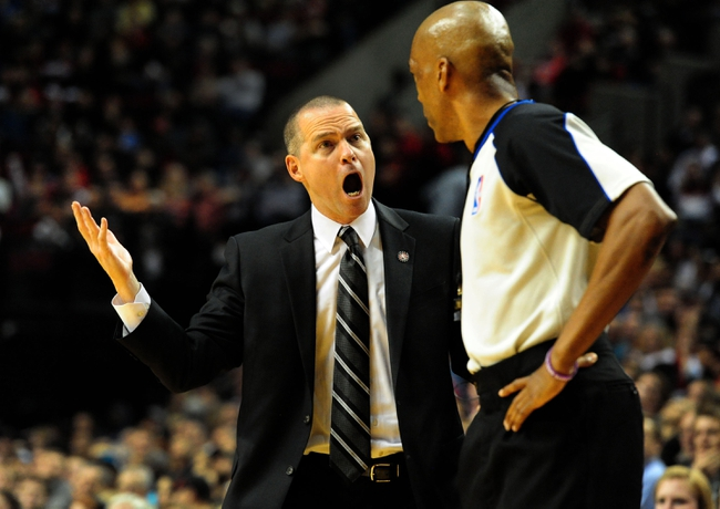 Nov 8, 2013; Portland, OR, USA; Sacramento Kings head coach Michael Malone has some words with referee Leon Wood (40) during the fourth quarter of the game against the Portland Trail Blazers at the Moda Center. The Blazers won the game 104-91. Mandatory Credit: Steve Dykes-USA TODAY Sports
