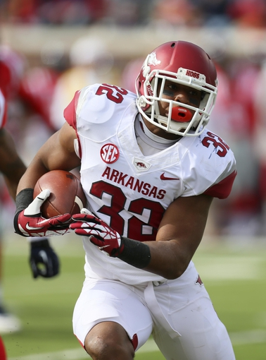 Nov 9, 2013; Oxford, MS, USA; Arkansas Razorbacks running back Jonathan Williams (32) advances the ball during the game against the Mississippi Rebels at Vaught-Hemingway Stadium. Mandatory Credit: Spruce Derden-USA TODAY Sports