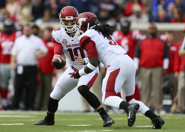 Nov 9, 2013; Oxford, MS, USA; Arkansas Razorbacks quarterback Brandon Allen (10) hands the ball off to running back Alex Collins (3) during the game against the Mississippi Rebels at Vaught-Hemingway Stadium. Mandatory Credit: Spruce Derden-USA TODAY Sports