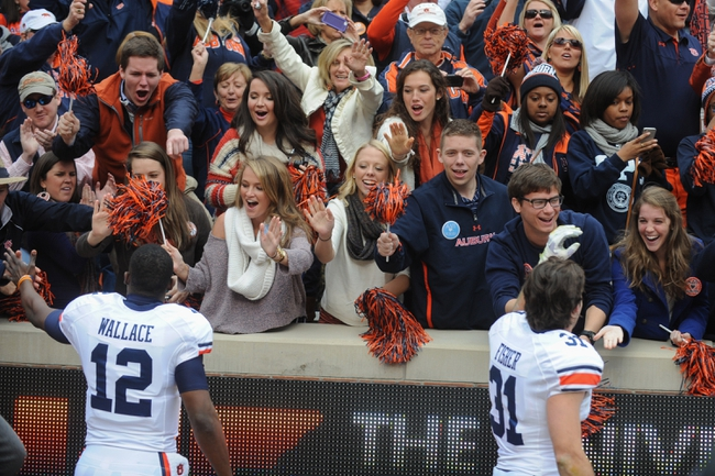Nov 9, 2013; Knoxville, TN, USA; Auburn Tigers quarterback Jonathan Wallace (12) and defensive back Trent Fisher (31) celebrate with fans after the game against the Tennessee Volunteers at Neyland Stadium. Auburn won 55 to 23. Mandatory Credit: Randy Sartin-USA TODAY Sports