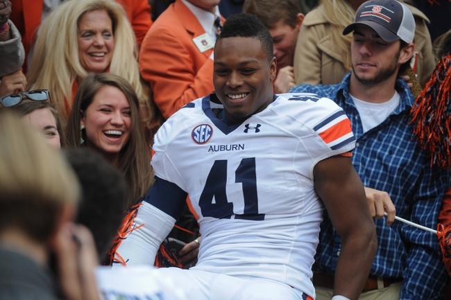Nov 9, 2013; Knoxville, TN, USA; Auburn Tigers running back Patrick Lymon (41)  celebrates with fans after the game against the Tennessee Volunteers at Neyland Stadium. Auburn won 55 to 23. Mandatory Credit: Randy Sartin-USA TODAY Sports