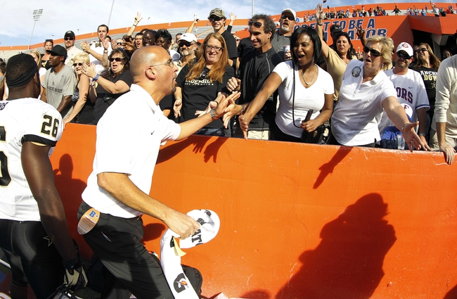 Nov 9, 2013; Gainesville, FL, USA; Vanderbilt Commodores head coach James Franklin celebrates with fans after the game against the Florida Gators at Ben Hill Griffin Stadium. Vanderbilt Commodores defeated the Florida Gators 34-17. Mandatory Credit: Kim Klement-USA TODAY Sports