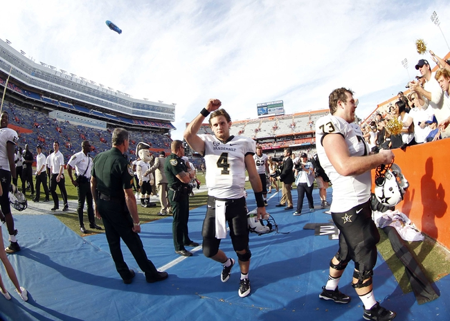 Nov 9, 2013; Gainesville, FL, USA; Vanderbilt Commodores quarterback Patton Robinette (4) pumps his fist and celebrates after they beat the Florida Gators at Ben Hill Griffin Stadium. Vanderbilt Commodores defeated the Florida Gators 34-17. Mandatory Credit: Kim Klement-USA TODAY Sports