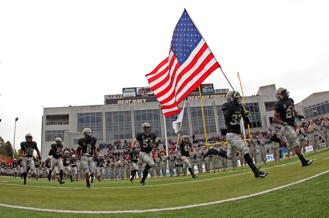 Nov 9, 2013; West Point, NY, USA; Army Black Knights defensive back Shaquille Tolbert (33) carries the American flag out to the field with teammates before the first half at Michie Stadium. Mandatory Credit: Danny Wild-USA TODAY Sports